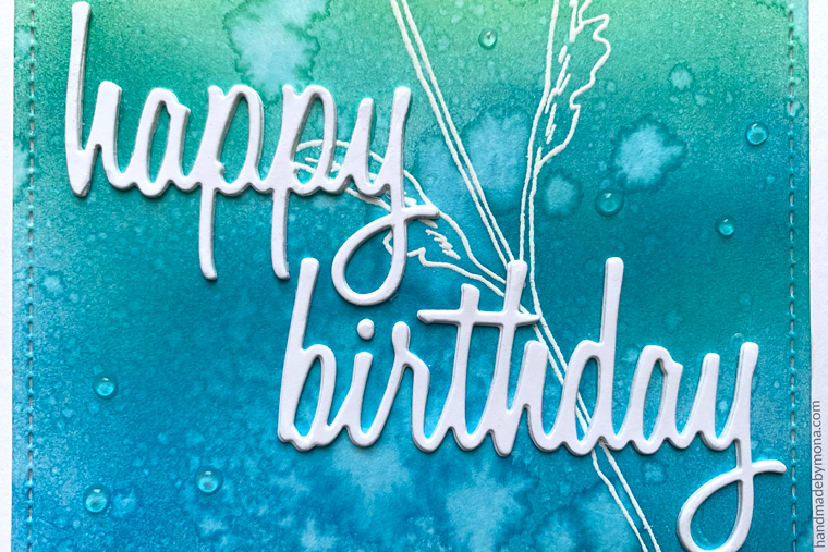 Sizzix Thinlit Happy Birthday Die with distress ink background